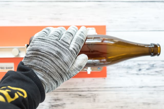 cutting a bottle with the home pro bottle cutter