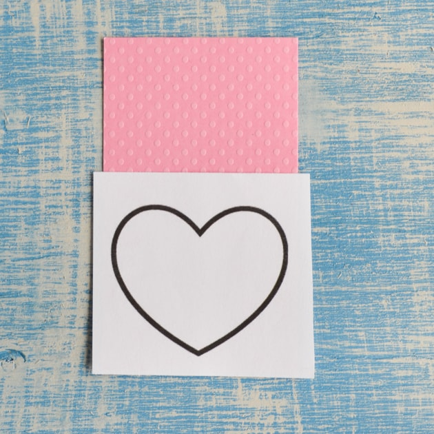 cut larger paper heart