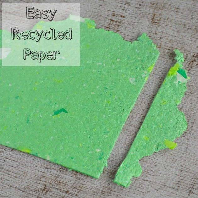 """text """"easy homemade recycled paper"""" over the top of a piece of homemade green paper"""