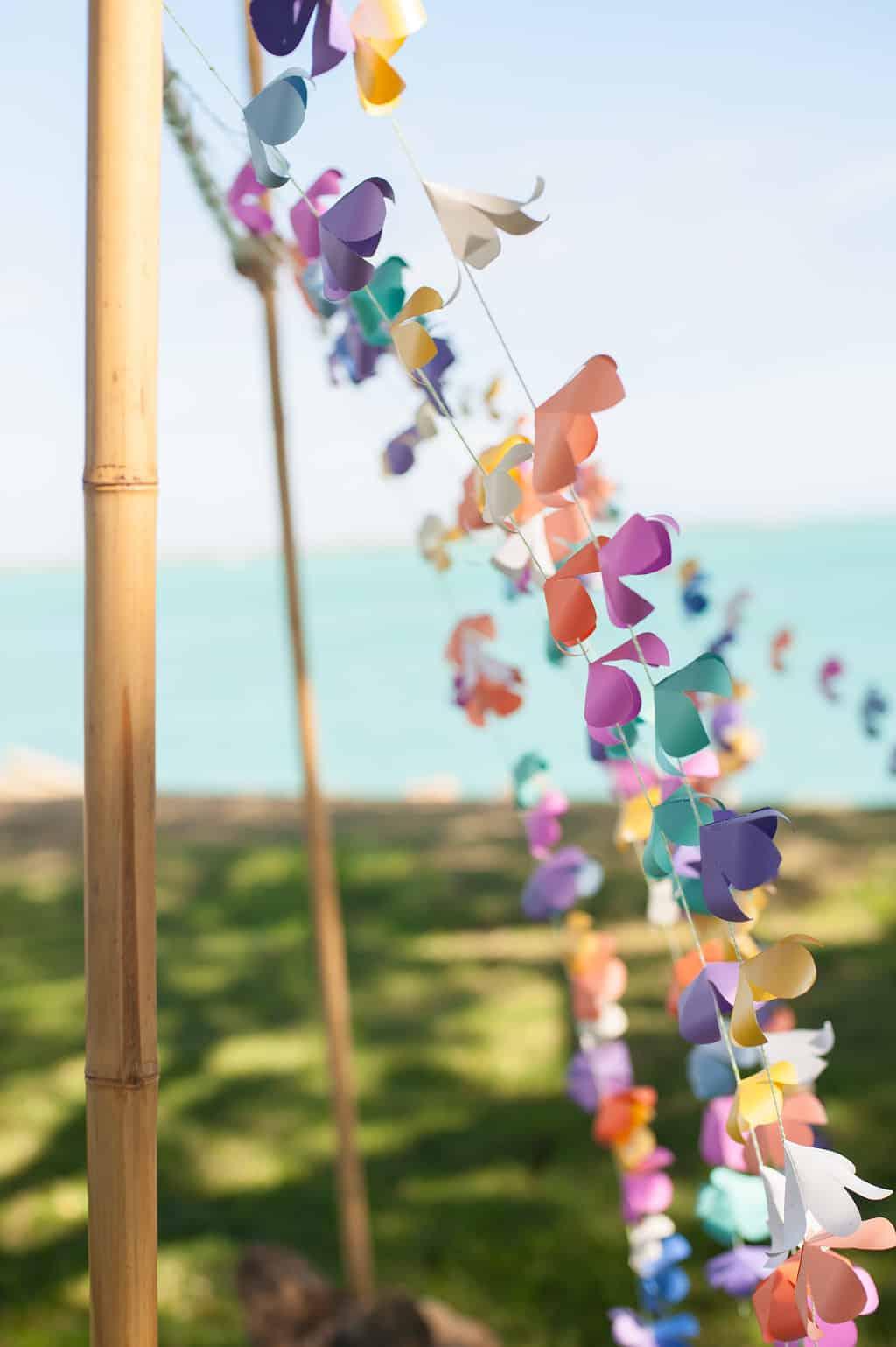 DIY wedding arch with paper flower lei garland