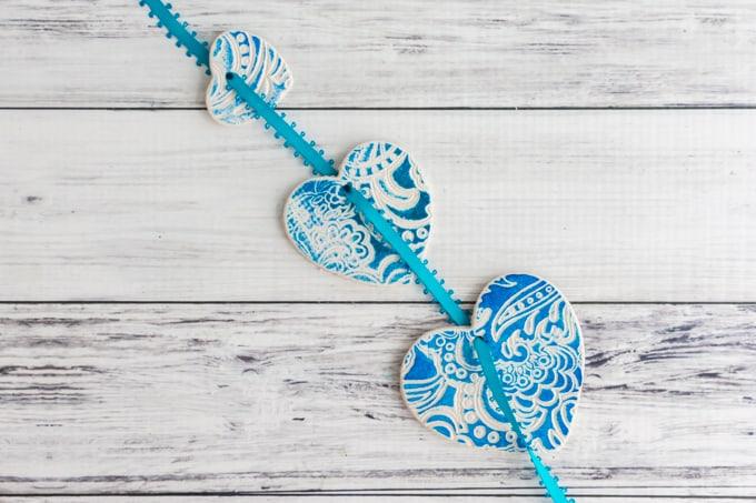 thread ribbon through ornaments