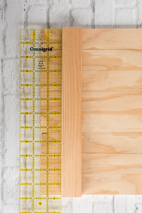 place ruler along the boards