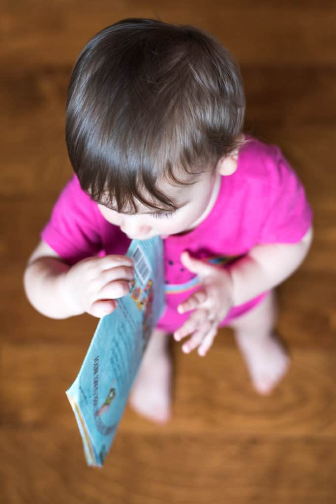 Baby chewing on an Indestructibles Book