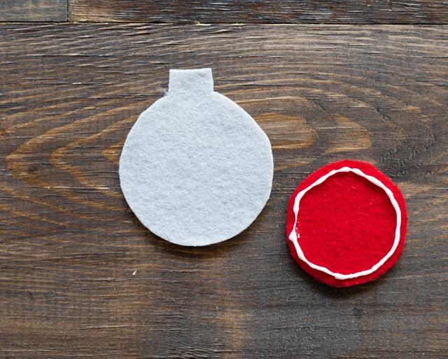 glue the felt pieces togther for no sew felt Christmas ornaments