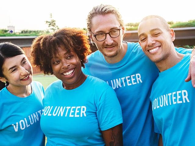 volunteers in blue shirts
