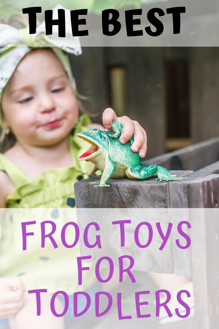Toddler playing with a frog toy