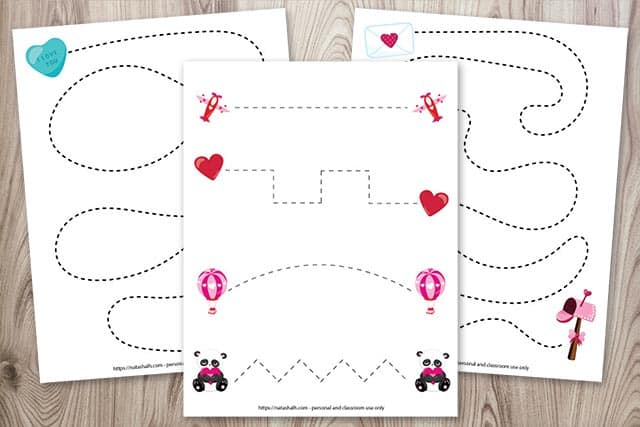 Three fine motor/pre-writing practice sheets for preschoolers featuring Valentine's Day images
