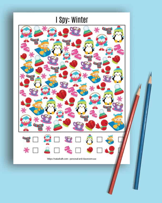 preview of a difficult winter I spy printables on a blue background with two pencils