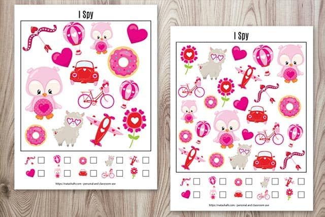 Two Valentine's Day I spy printables on a wood background