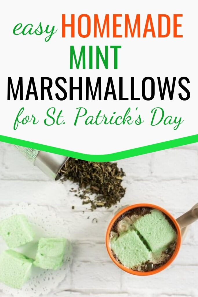 """text """"easy homemade mint marshmallows for St. Patrick's Day"""" with a picture of homemade mint marshmallows in a mug of hot chocolate."""