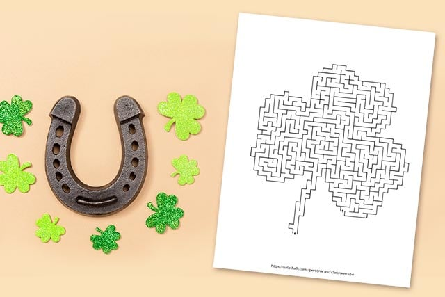 printable difficult shamrock shaped maze next to a horseshoe
