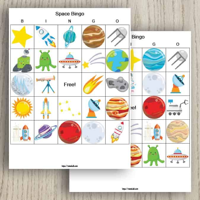 Two free printable outer space bingo cards. The cards feature a 5x5 grid of cartoon space images including planets, satellites, telescopes, and stars.