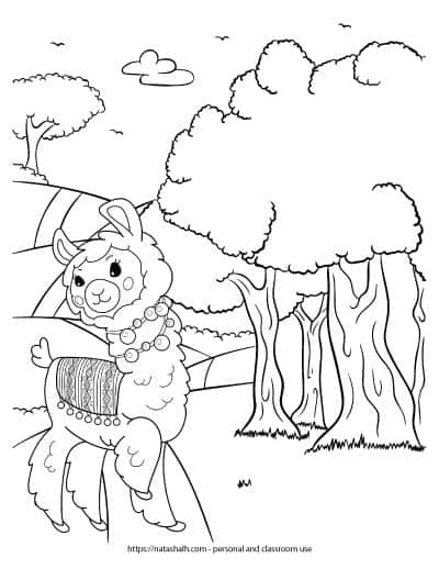 A cute llama walking on a path in the woods. The llama has a blanket with pompoms on it and two pompom necklaces. The llama is standing on a path that runs over hills next to several trees.