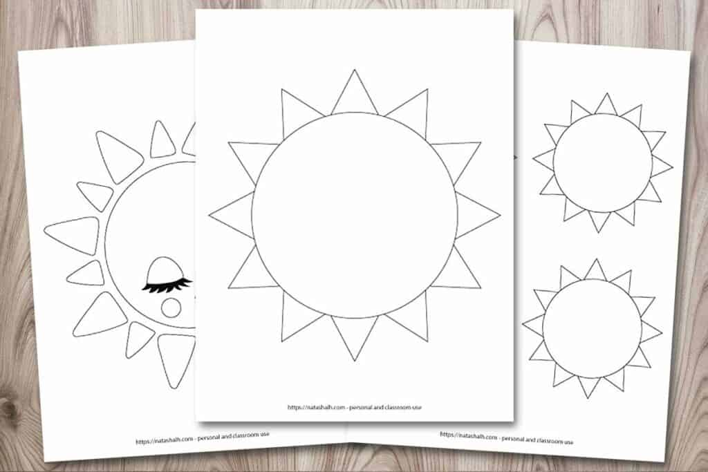 """A rectangular image showing a mockup of three printable sun templates on a wood background. The front and center printable has a large simple sun outline that fills the entire page. Behind this sun and to the left is a partially obscured cute sun. It has closed eyes, long eyelashes, and a smile. On the right is a page with three medium sun templates. These suns are 3.75"""" across when printed and there are four on one page. Half of the page is concealed behind the center sun."""