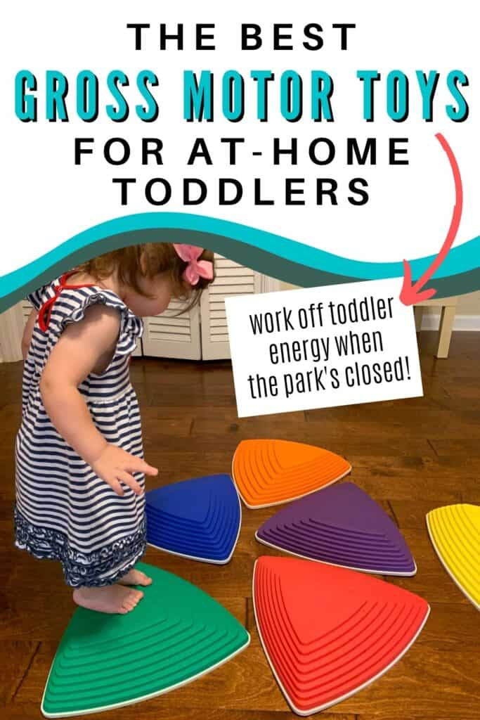 """Text """"the best gross motor toys for at-home toddlers"""" There is an arrow pointing at additional text """"work off toddler energy when the park's closed!"""" Below the text is a picture of a young toddler in a blue and white striped dress using plastic stepping stones on a wood floor."""