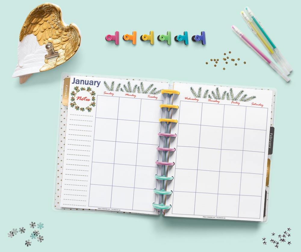An open Happy Planner Classic discount planner on a teal surface. The planner is open to a two week January monthly spread with watercolor greenery decorations.