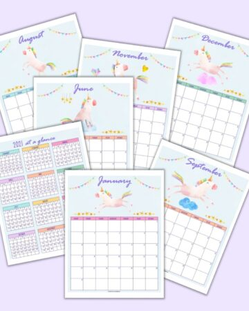 a flatlay mockup of 7 printable unicorn calendar pages for 2021 including a year at a glance page and monthly pages