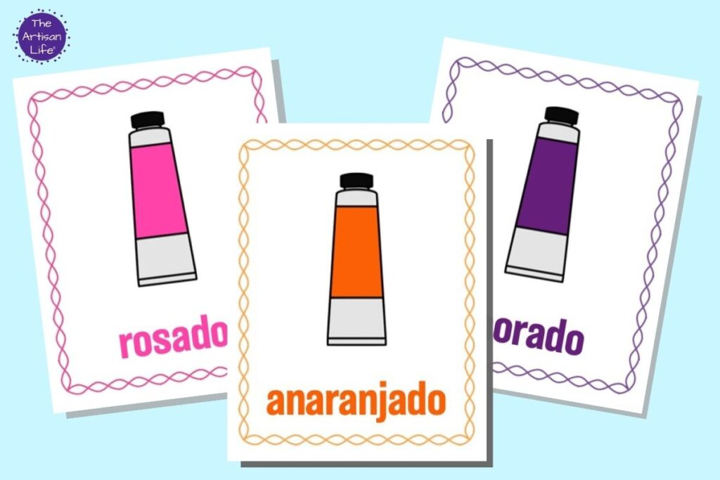Three printable color posters in Spanish. Each page has a cartoon tube of paint, the color's name, and a border in the same color. Colors are orange, pink, and purple.
