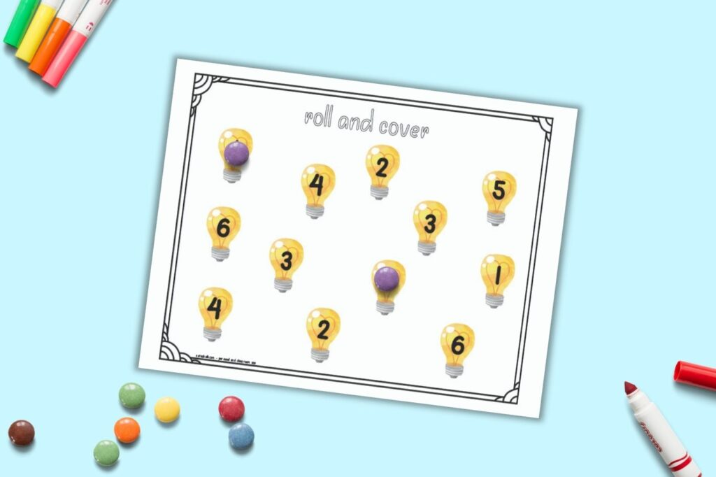 A printable roll and cover mat for preschool math. The page has the numbers 1-6 two times apiece. Each number is in the center of a light bulb. Purple round candies cover two of the numbers and an additional pile of candies is on the bottom left of the image.