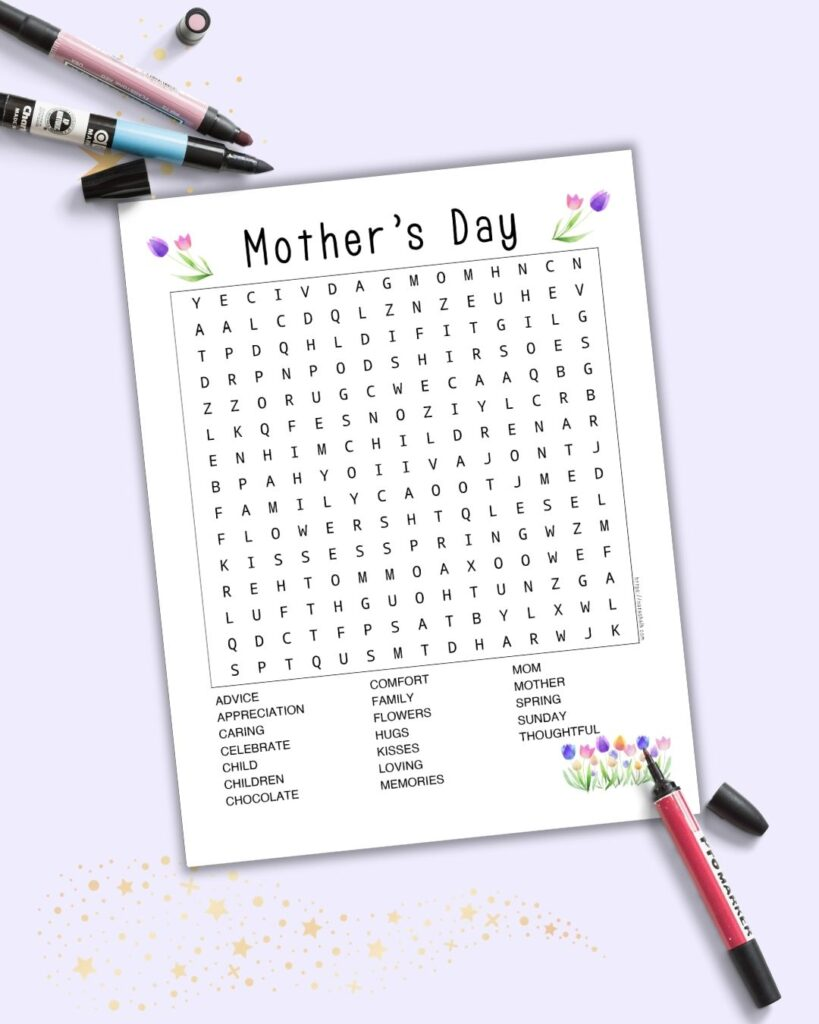 A flatlay mockup of a printable Mother's Day word search on a light purple background with a pink, red, and a blue marker.