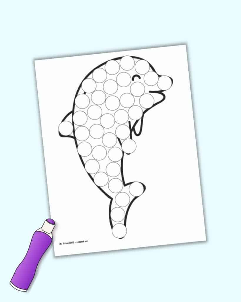 A preview of a free printable dolphin dot marker coloring page with an illustrated purple dauber marker
