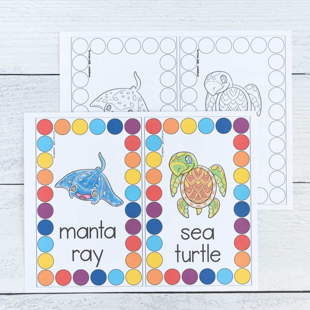 A preview of a color page and a black and white page of roll and count mats. Each page has two cards to cut apart and use. An ocean animal is in the center of each card. It is surrounded by a rectangle comprised of large circles to cover.