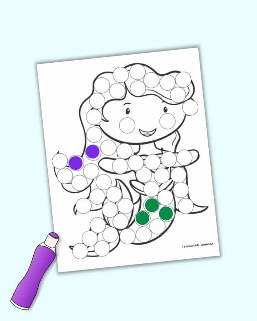 A preview of a mermaid dot marker printable with three green dots on her tail and two purple dots on her hair.