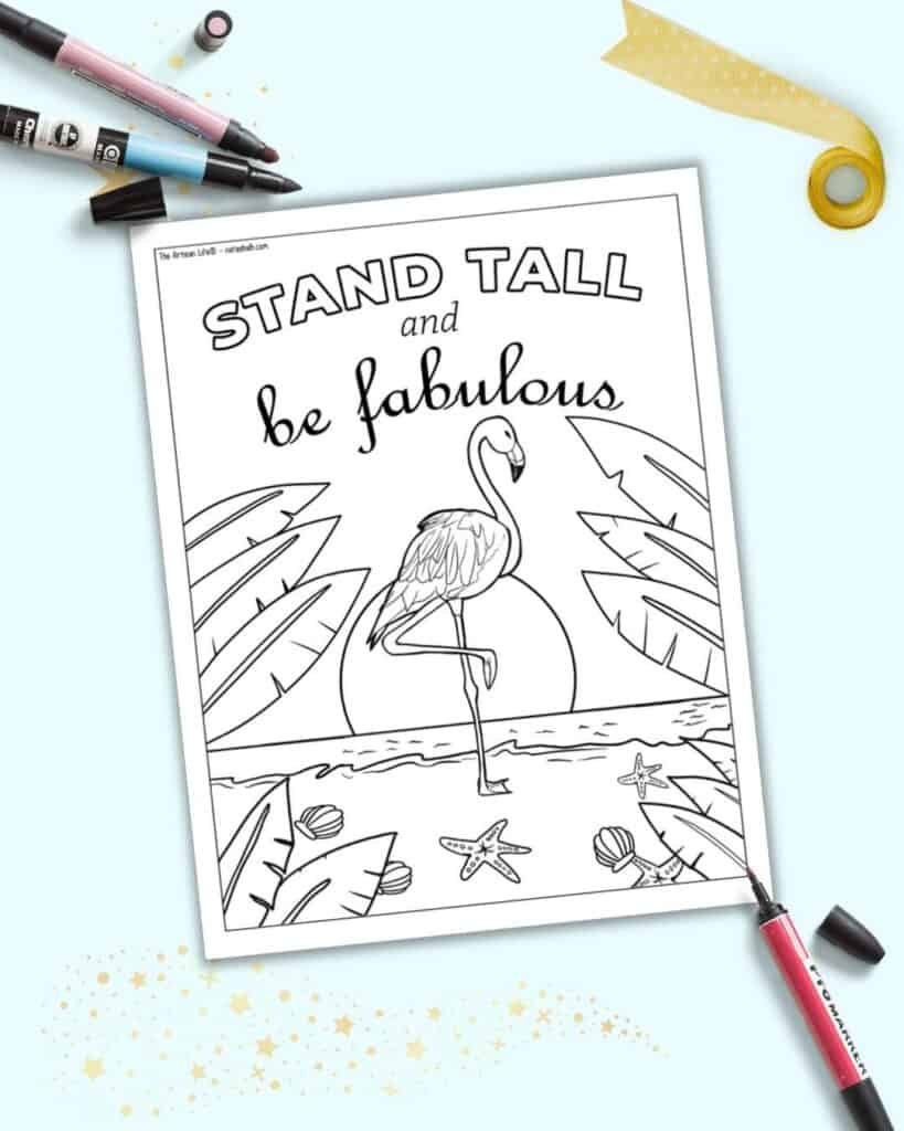 """A preview of a coloring page with a flamingo on the beach and the phrase """"stand tall and be fabulous"""""""