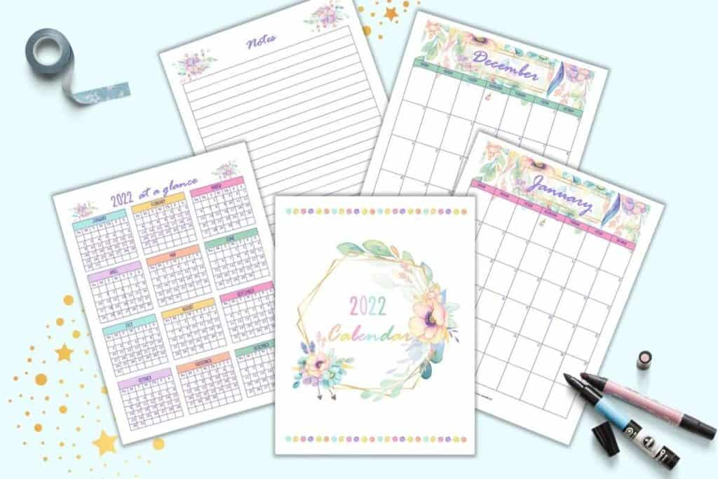a preview of 5 floral themed 2022 calendar pages including a cover page, year at a glance, January, December, and notes page with lines.