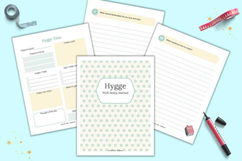 A preview of four pages of a hygge themed journal and planner. Pages include a cover page, daily planner, and two pages of journal paper with writing prompts.