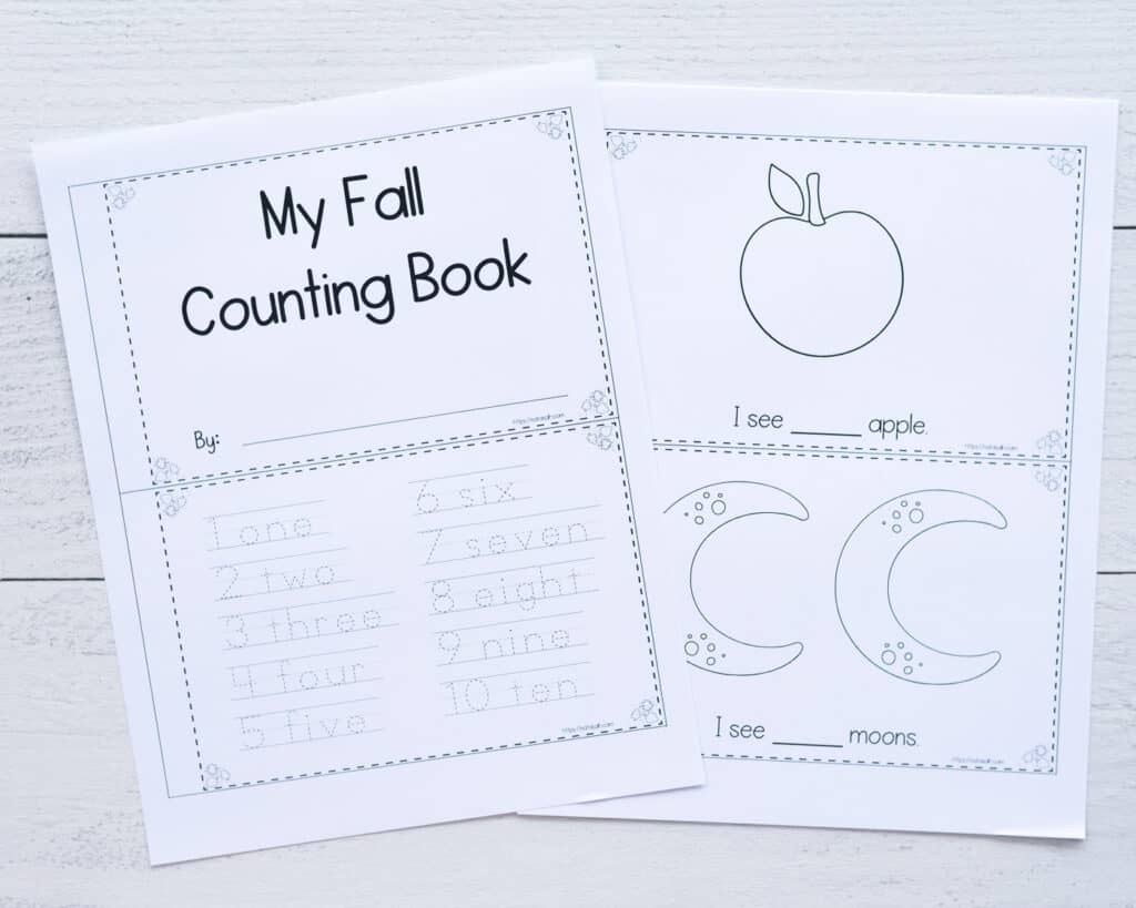 """A preview of two printed fall counting book pages. Each sheet has two pages to cut apart to make a reader for pre-k students. The page on the left has """"My fall counting book"""" above and numbers 1-10 to trace below. On the right is """"I see (one) apple"""" and """"I see (two) moons"""""""